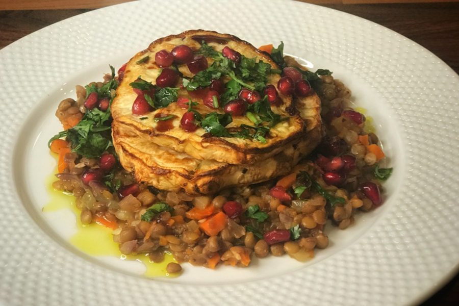 Celeriac steaks with sweet, sticky date and Baharat spiced lentils