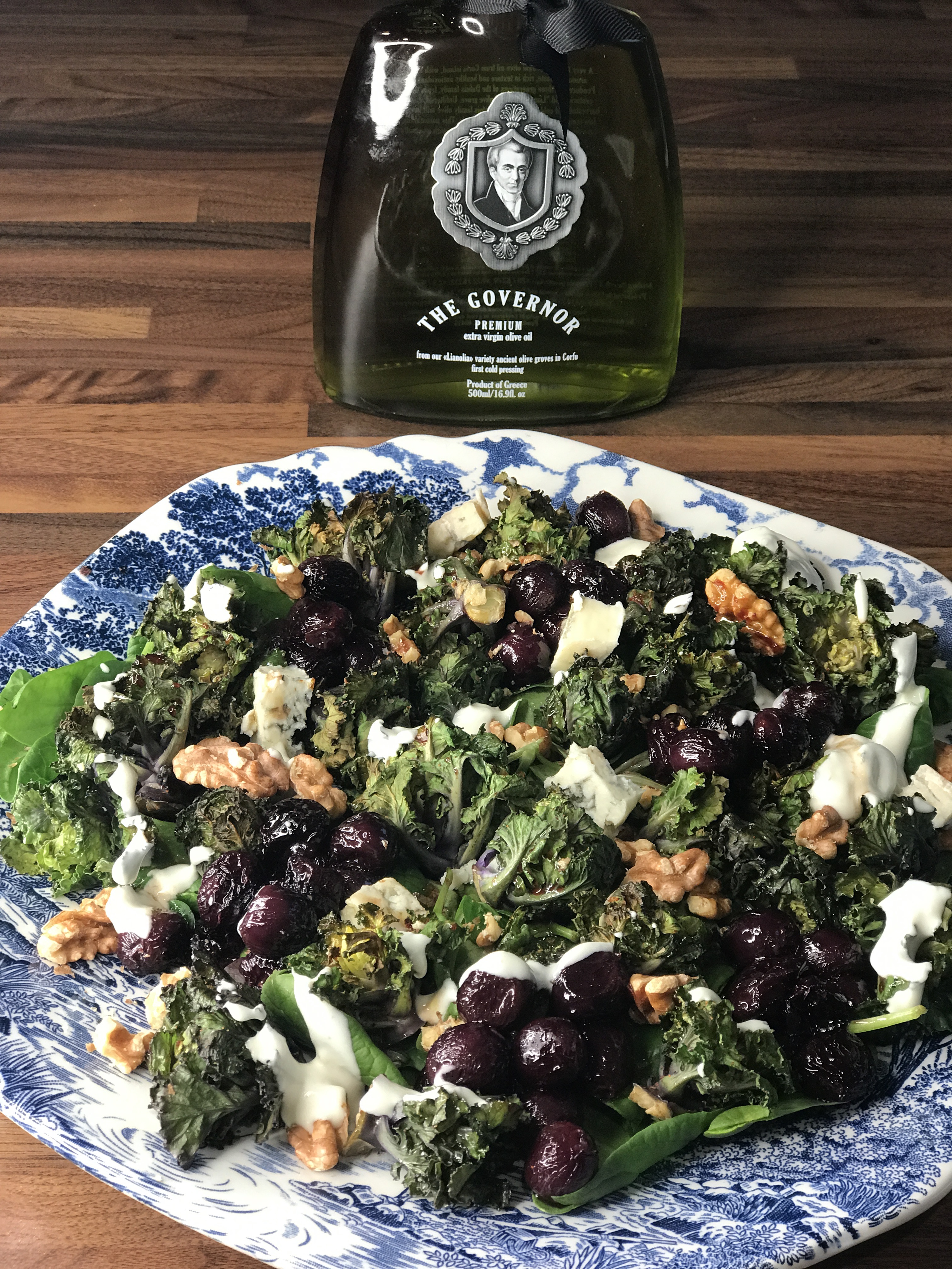 Kalette salad with roasted grapes, walnuts and a healthier blue cheese dressing